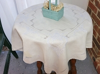 White table Topper with Light Blue Embroidery